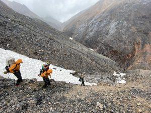 Scientists scramble down steep slope